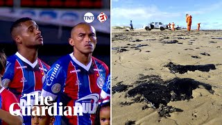 Brazilian footballers protest oil spill with custom-made shirts and gloves