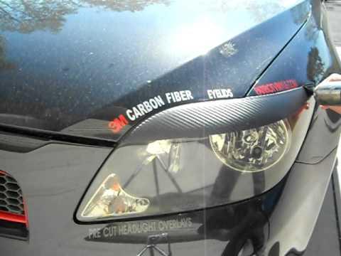 Scion tC Head light Eyelid OverlayCarbon Fiber