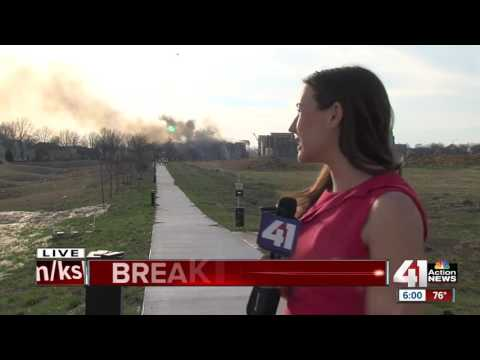 Overland Park apartment fire spreading to other homes