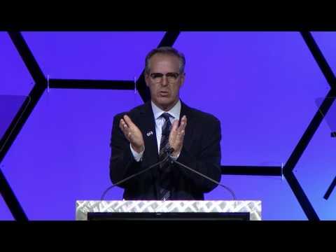 Rolf Benirschke speaking at the IHE Keynote