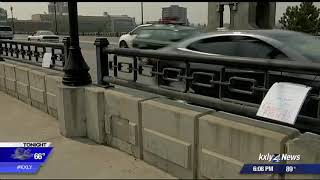 Suicide prevention signs hung on Monroe Street Bridge