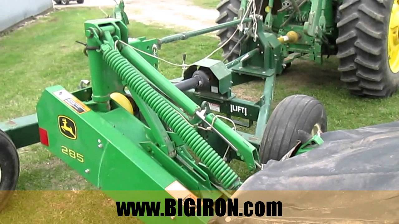 BIG IRON ONLINE AUCTION 5-4-2016: 2009 John Deere 285 Disk Mower with KMC  4760 Caddy