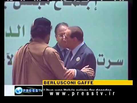 Berlusconi kisses Gaddafi's hand