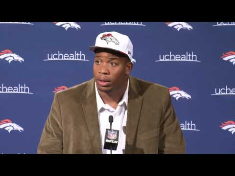 Bill Kollar introduces DeMarcus Walker to the Broncos