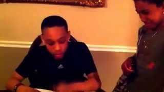 Haitian father sees report card
