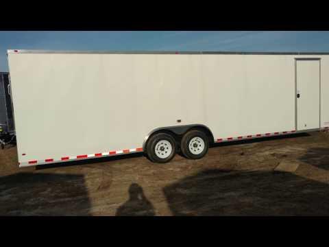 8.5x28 enclosed trailer white in color