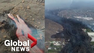 La Palma volcano: Drone video shows lava flowing from new vent, ash raining from crater
