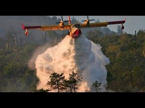 Fire Fighting Airplanes in Action - Lockheed Electra Tanker