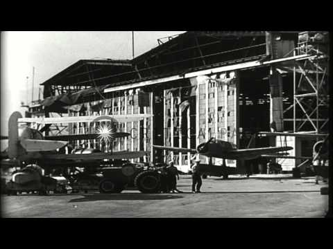 Wrecked planes, hangars and ships in Pearl Harbor, Hawaii, following attack by Ja...HD Stock Footage
