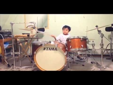 Little Kid Playing Tom Sawyer On Drums