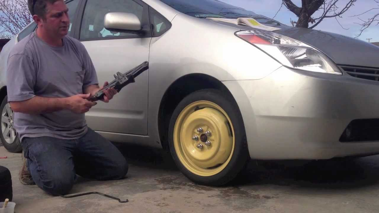 how to get a spare tire from under the car  | youtube.com