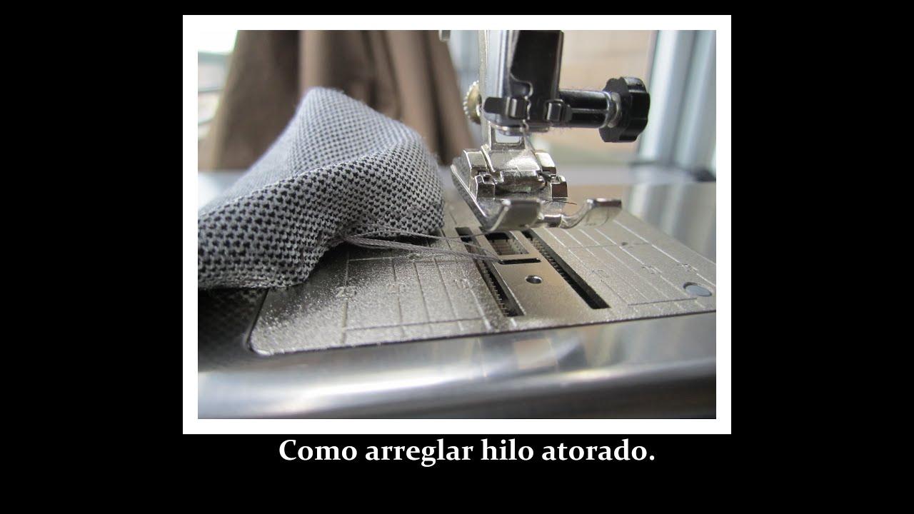Como arreglar hilo atorado en maquina de coser. - YouTube