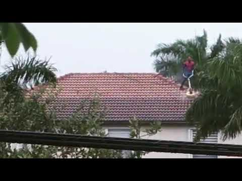Florida Front Row - Spiderman Seen Pressure Washing Roof Of Miami Home