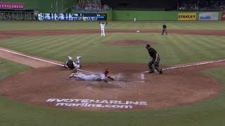 Kozma slides home safely on sacrifice fly