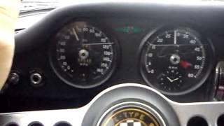 driving along the A4 on a Jaguar E type 3.8 FHC