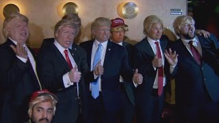 Imagine 11 Papaya-Colored Trumps Storming the Stage at the Laugh Factory for Trump Impersonation Day Competition