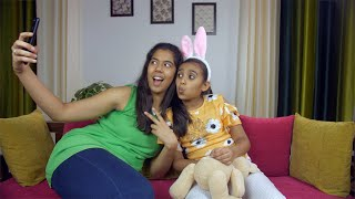 Happy Indian siblings pouting while taking selfies with a smartphone - leisure time