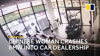 Chinese woman plunges BMW into car dealership while taking a test drive