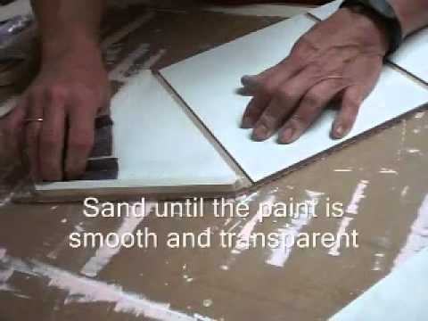 Painting a Dollhouse sand after the first coat