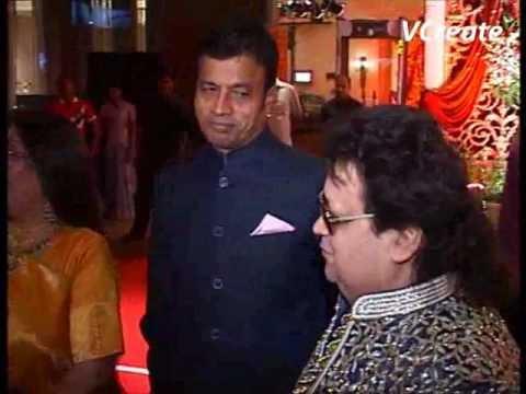 Bappi Lahiri and his wife Chitrani on their son Bappa Lahiri's marriage party.flv