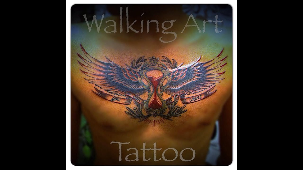 Tattoo Clock Wing Chest: Tattooing Wings And Sand Clock On The Chest .