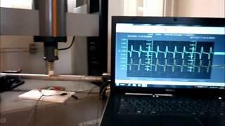 圧電素子のスプレーコーティング工法 応力負荷計測の様子