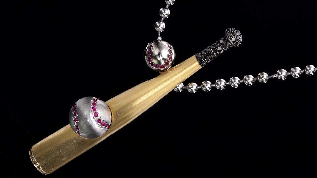 Gold baseball bat diamond pendant with gold and ruby baseballs on