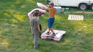 Roofers in Beastmode Carrying 4 Bundles