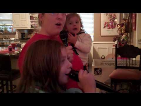 Macy, Heather, Addie singing on the new Karaoke machine Chri