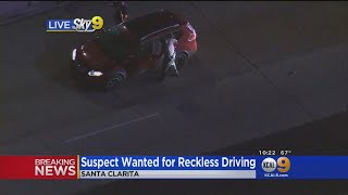 Pursuit Ends With Female Suspect Being Dragged From Vehicle