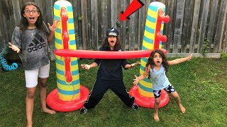 Kids play Inflatable Limbo Challenge with Police!!  Kids pretend play family fun game