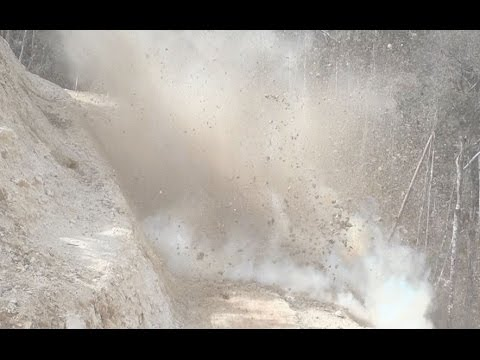 Blasting the road up the mountain, Papua New Guinea