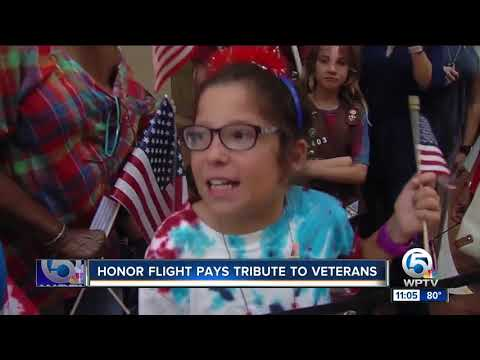 Thousands of people pack the PBIA concourse to welcome home Honor Flight