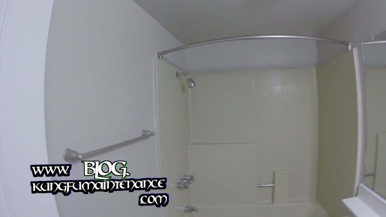 how to install a curved shower curtain rod | www.myfamilyliving.com