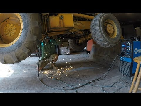 Welding the dozer and backhoe