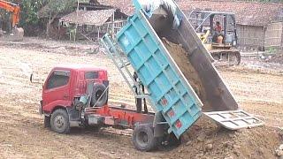 Dump Truck Dyna By Toyota Unloading Dirt