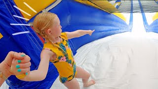 4 yr old tries the world's LARGEST inflatable WATERSLIDE *reaction*