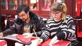 Foreigners learning Chinese calligraphy and Spring Festival couplets