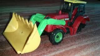 Игрушка Трактор с ковшом / Tractor with a bucket Toy
