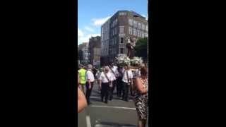 Italian procession through the streets of Little Italy in London