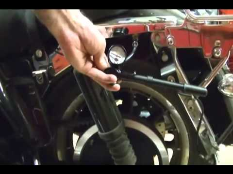 Motorcycle Repair: Adjusting the Rear Suspension Air System Shocks on a  Harley Davidson