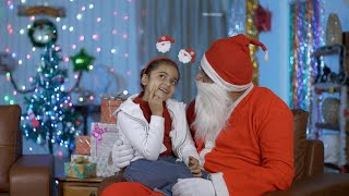 Old Santa and cute little girl happily spending a perfect Christmas holiday in India