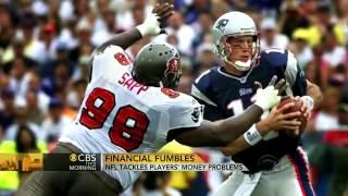 Why NFL players go broke - CBS News.flv