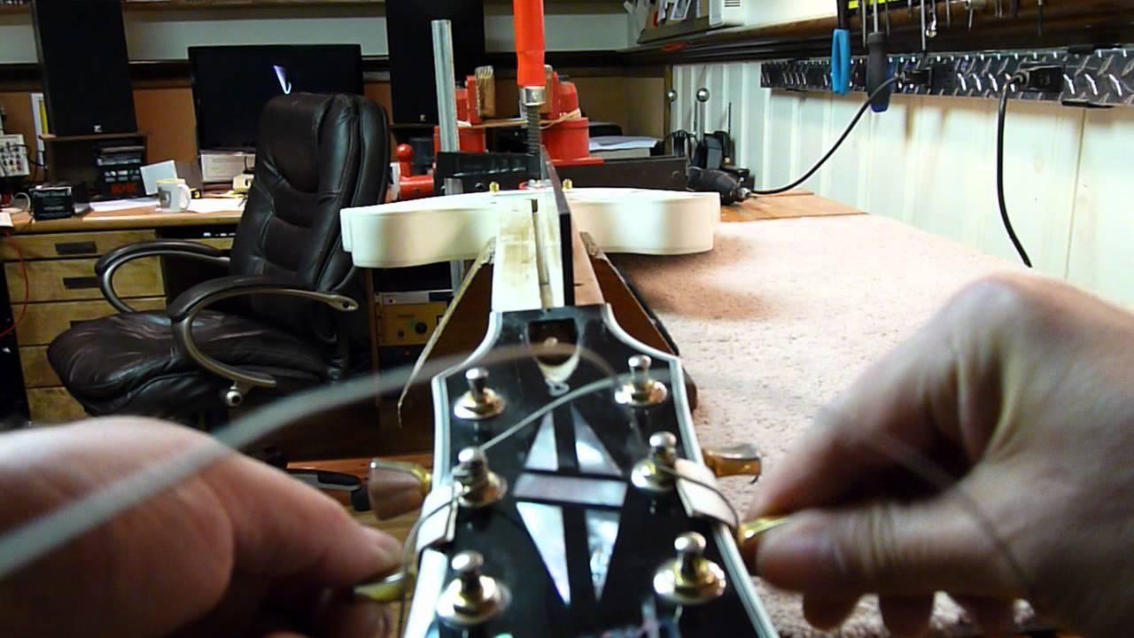 how to fix a bowed guitar neck