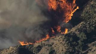 Raging California wildfires fuelled by strong winds