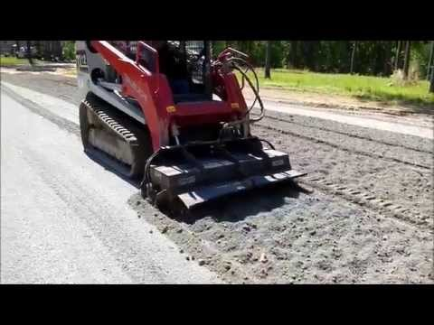 Skid Steer Tilling In Dirt