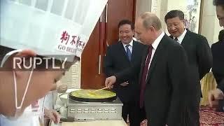 天津行,普京摊煎饼包包子