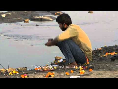 People offer leaf lamps on river Yamuna