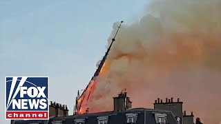 Notre Dame's iconic spire collapses in cathedral fire