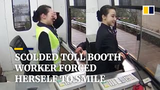 Scolded by driver, toll booth worker in China forces herself to smile
